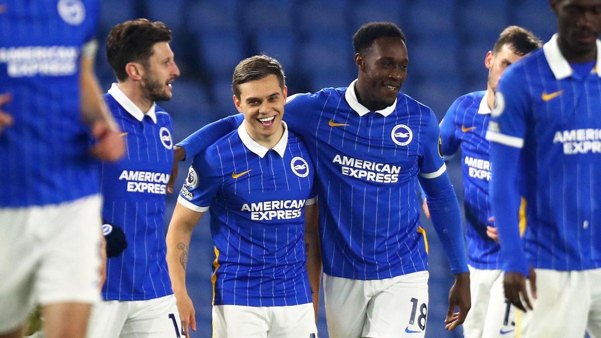 Brighton's English striker Danny Welbeck celebrates scoring his team's second goal with Brighton's Belgian midfielder Leandro Trossard