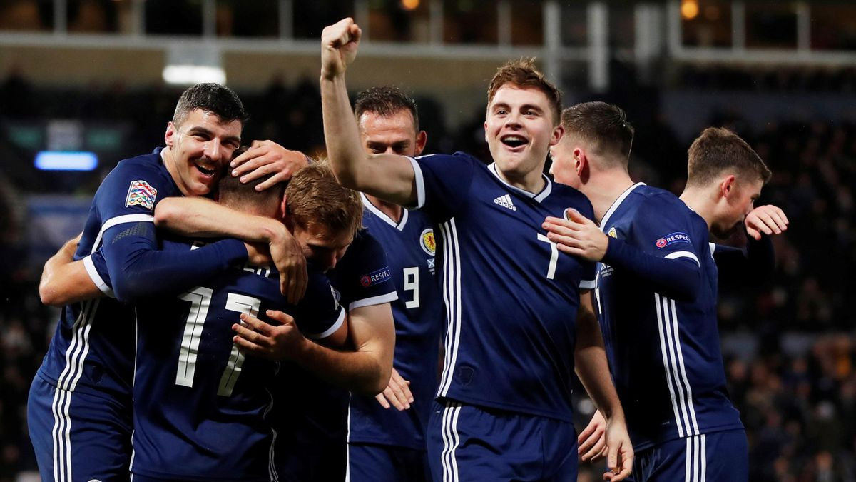 Scotland's James Forrest celebrates scoring their third goal to complete his hat-trick against Israel