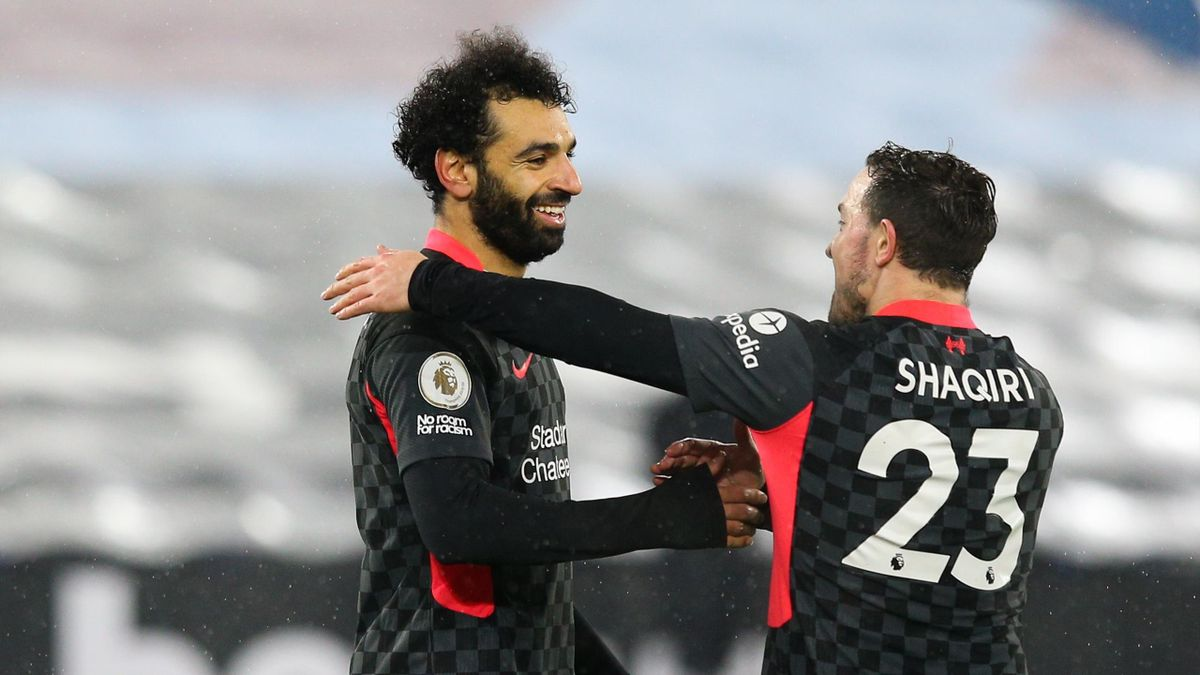 Mohamed Salah of Liverpool celebrates scoring his side's second goal with team mate Xherdan Shaqiri during the Premier League match between West Ham United and Liverpool at London Stadium
