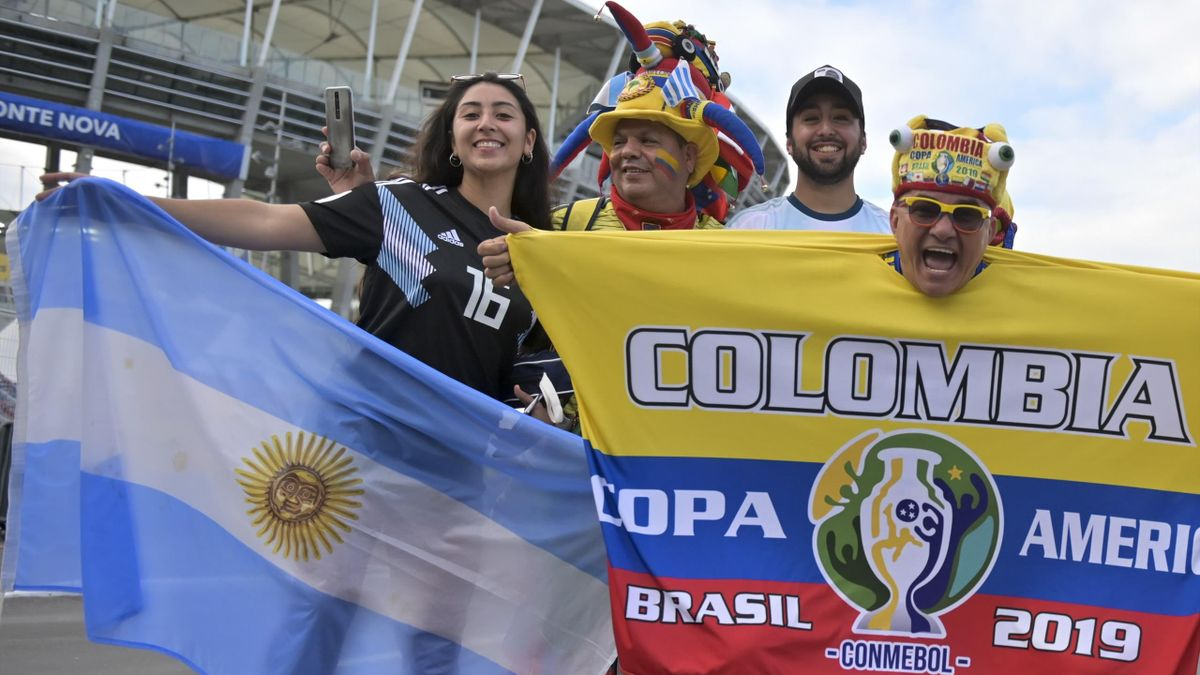 Fans of Argentina (L) and Colombia pose before the Copa America football tournament group match between their nations at the Fonte Nova Arena in Salvador, Brazil, on June 15, 2019.