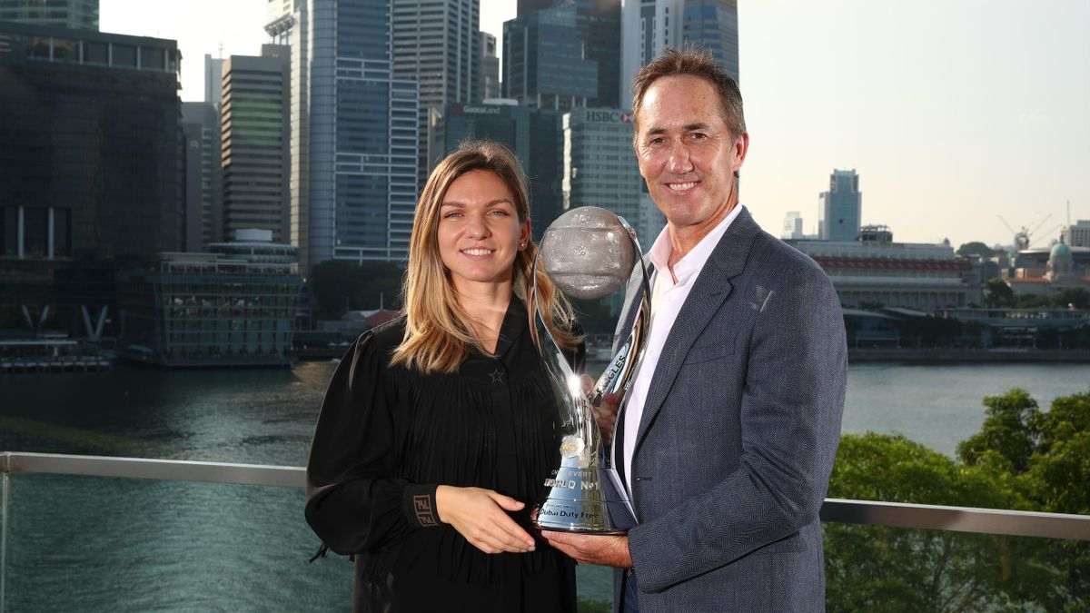 Simona Halep of Romania poses with her coach Darren Cahill after winning the Chris Evert WTA World No.1 trophy