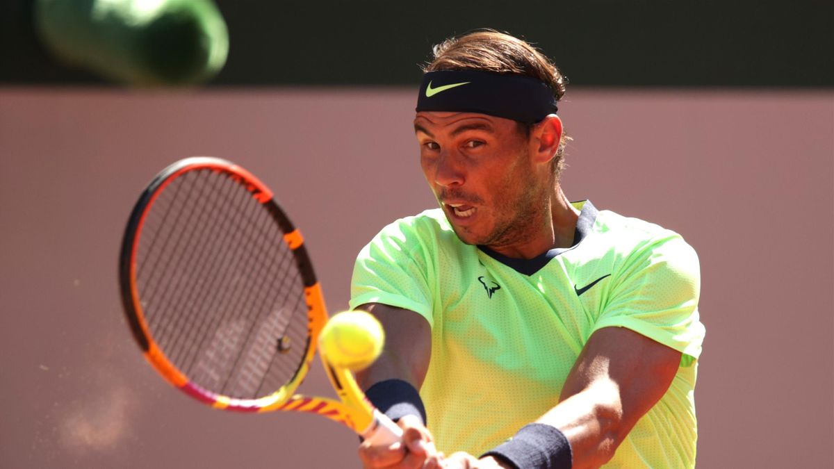 Rafael Nadal of Spain plays a backhand in their mens first round match against Alexei Popyrin of Australia during day three of the 2021 French Open at Roland Garros