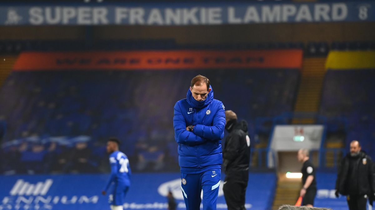 Thomas Tuchel the head coach / manager of Chelsea looks on with a banner for former head coach / manager Frank Lampard above him during the Premier League match between Chelsea and Wolverhampton Wanderers at Stamford Bridge on January 27, 2021 in London,