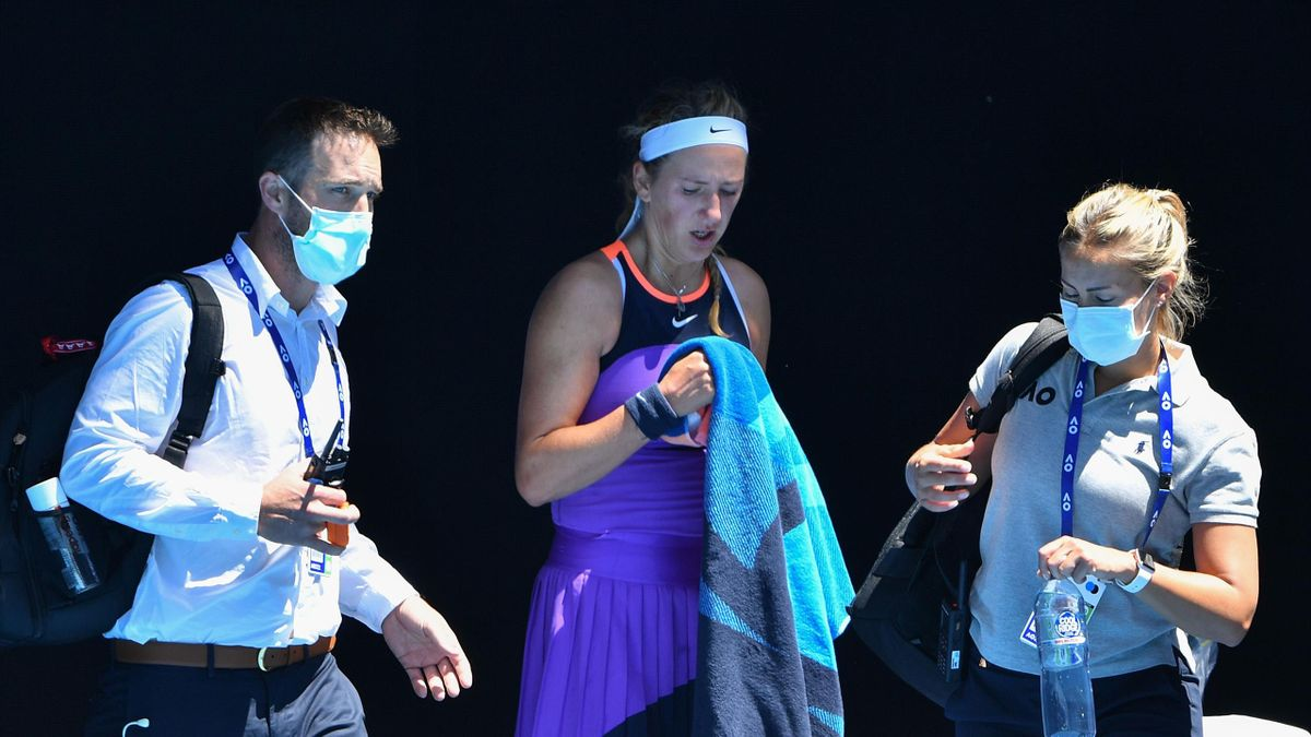 Belarus' Victoria Azarenka (C) leaves to receive medical attention as she plays against Jessica Pegula of the US during their women's singles match on day two of the Australian Open tennis tournament in Melbourne