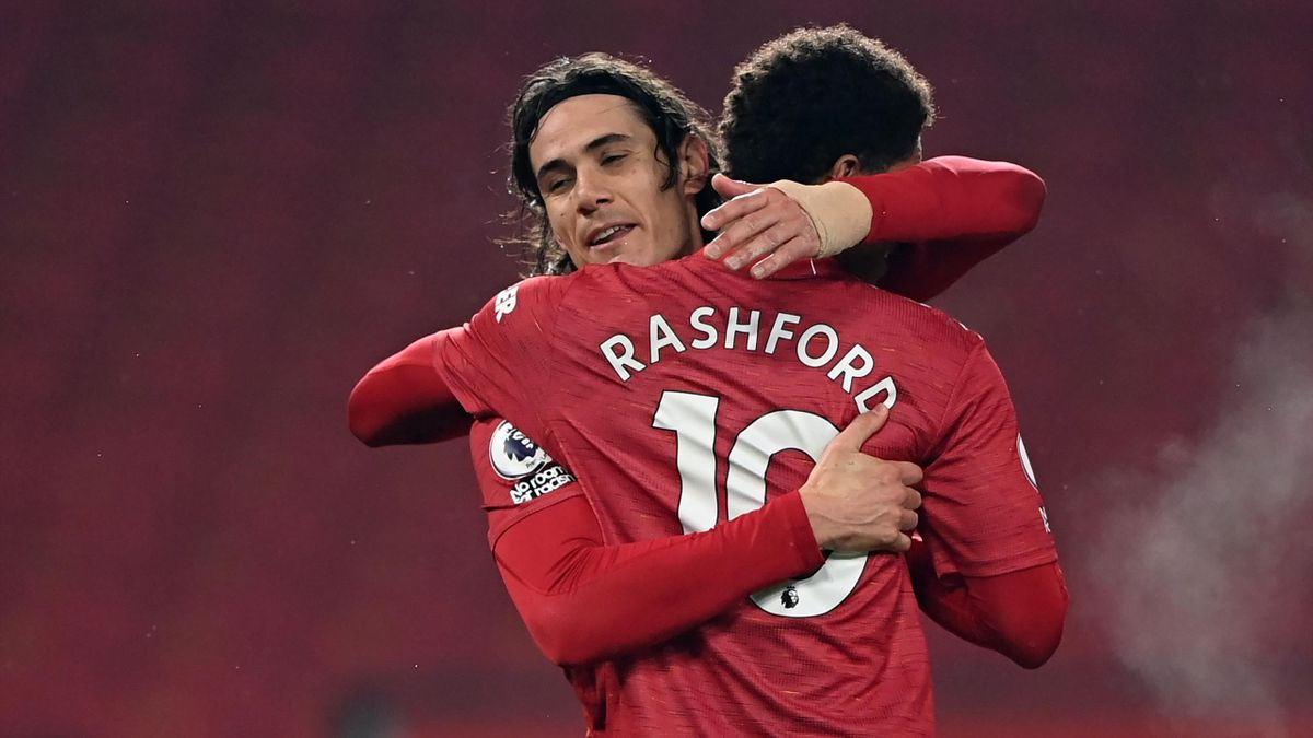 Manchester United's Uruguayan striker Edinson Cavani (L) celebrates with Manchester United's English striker Marcus Rashford after scoring their fourth goal during the English Premier League football match between Manchester United and Southampton at Old