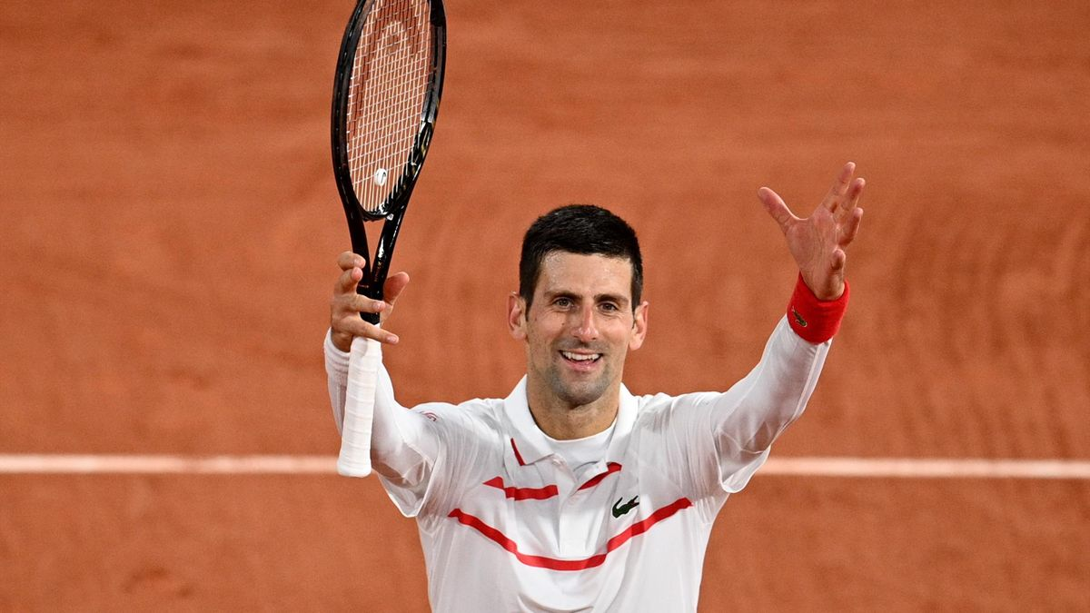 Serbia's Novak Djokovic celebrates after winning against Colombia's Daniel Elahi Galan at the end of their men's singles third round tennis match on Day 7 of The Roland Garros