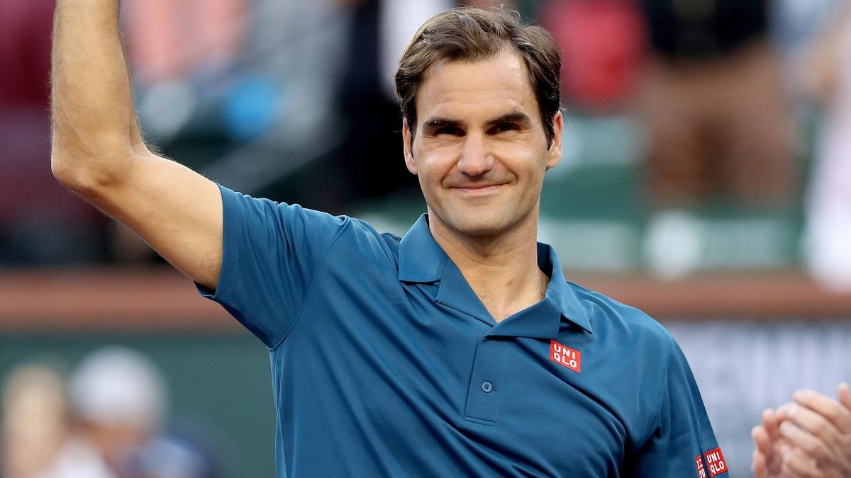 Roger Federer of Switzerland acknowledges the crowd after receiving the runners up trophy after losing to Dominic Thiem of Austria during the men's final of the BNP Paribas Open.