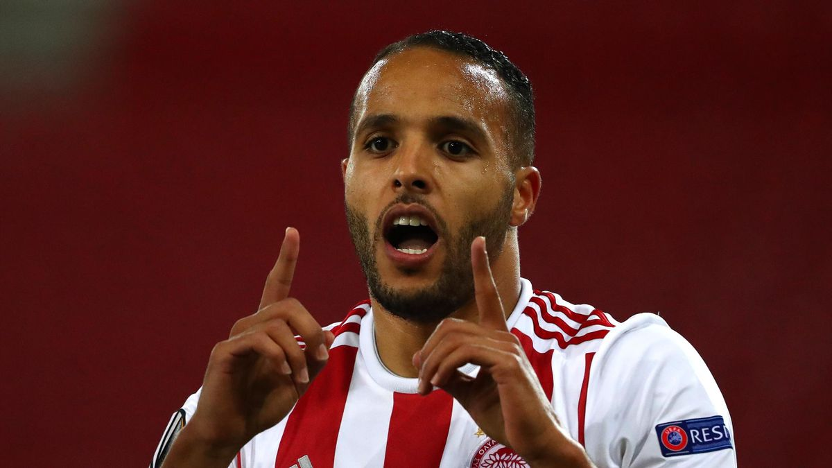 In this handout image provided by UEFA, Youssef El Arabi of Olympiacos FC celebrates after scoring his team's first goal during the UEFA Europa League round of 16 first leg match between Olympiacos FC and Wolverhampton Wanderers at Karaiskakis Stadium on