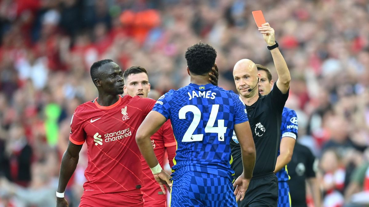Reece James of Chelsea is shown a red card by referee Anthony Taylor during the Premier League match between Liverpool and Chelsea at Anfield on August 28, 2021