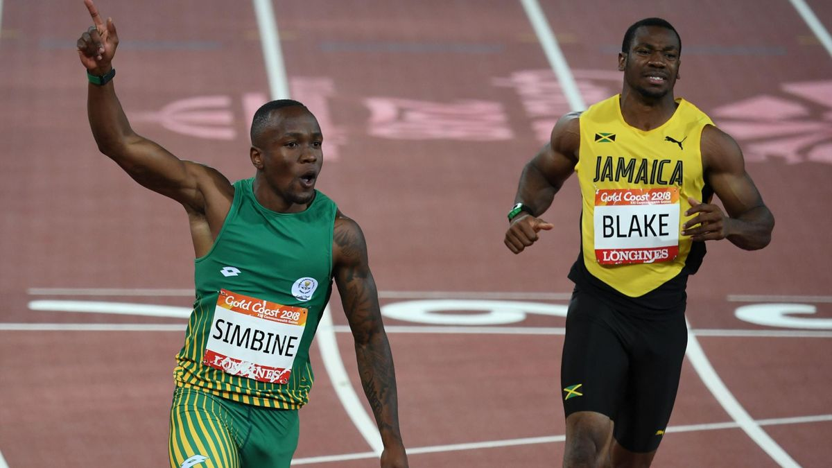 South Africa's Akani Simbine and Jamaicas Yohan Blake compete in the athletics men's 100m final during the 2018 Gold Coast Commonwealth Games at the Carrara Stadium on the Gold Coast