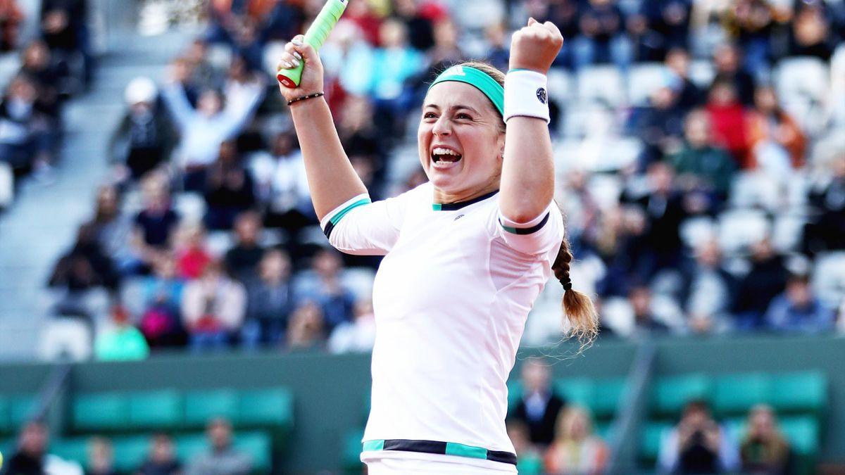 Jelena Ostapenko of Latvia celebrates victory during ladies singles Quarter Finals match against Caroline Wozniacki of Denmark.