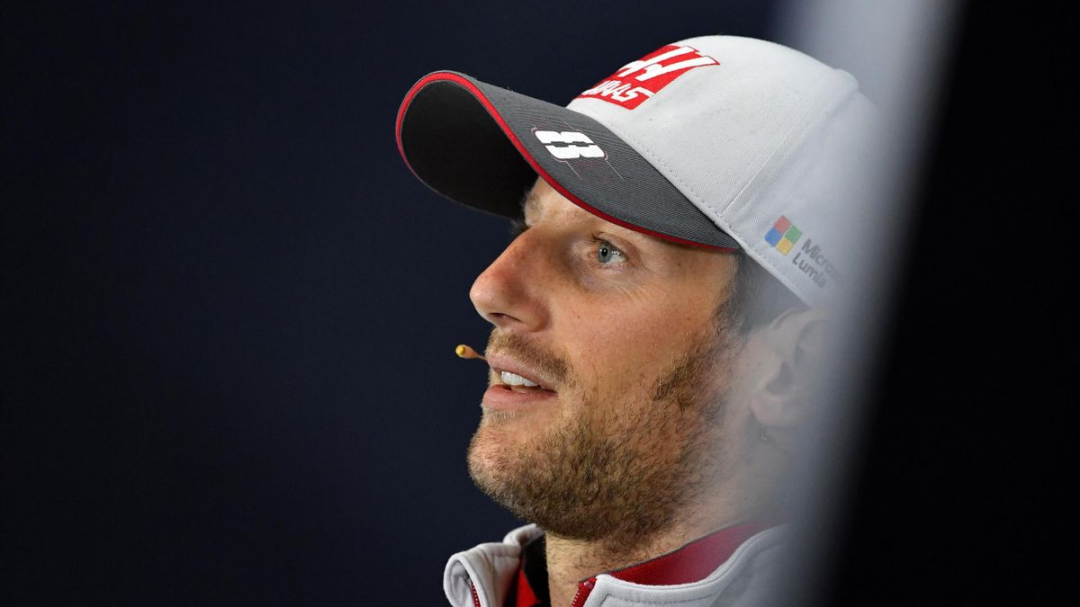 HAAS F1 Team's French driver Romain Grosjean smiles as he takes part in a joint press conference at the Silverstone circuit in Silverstone