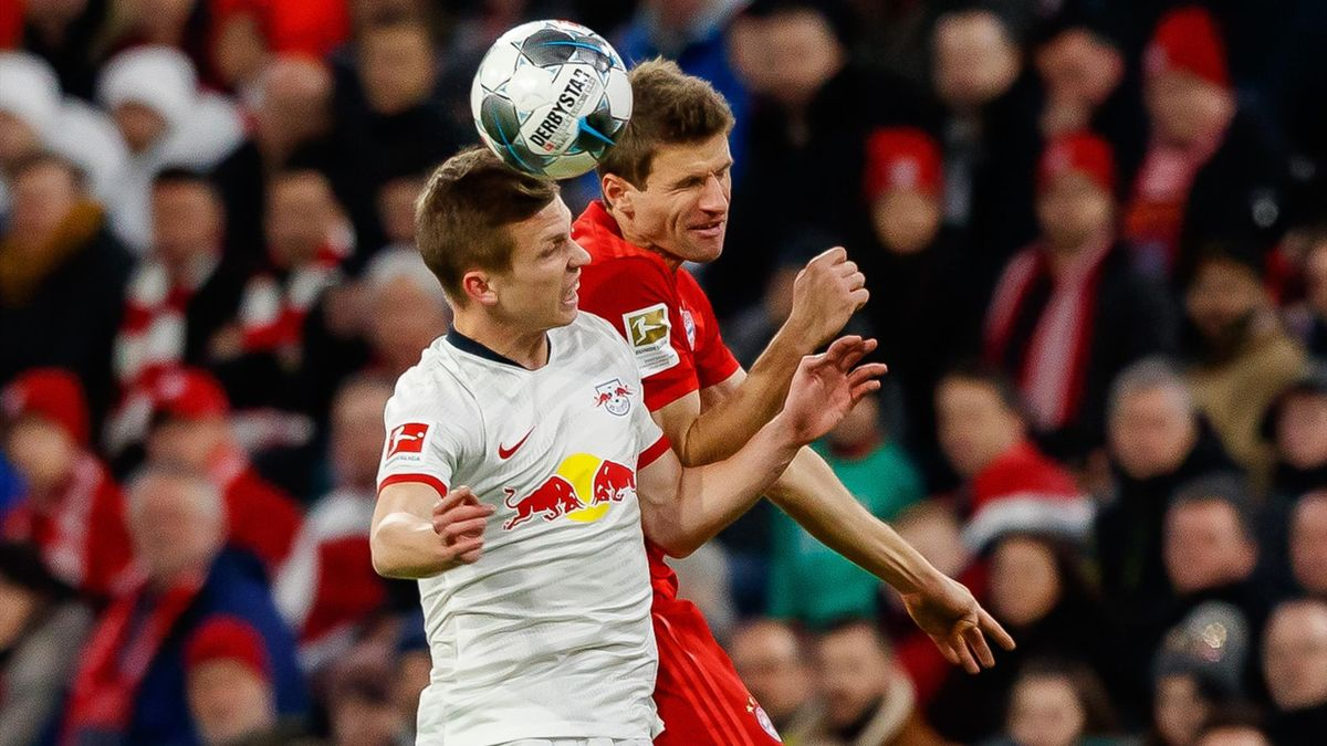 Dani Olmo of RB Leipzig and Thomas Mueller of FC Bayern
