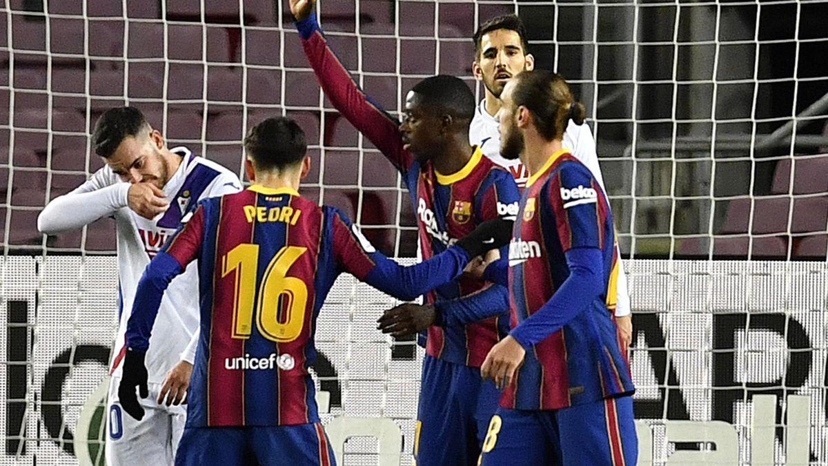 Ousmane Dembele celebrates scoring for Barcelona against Eibar