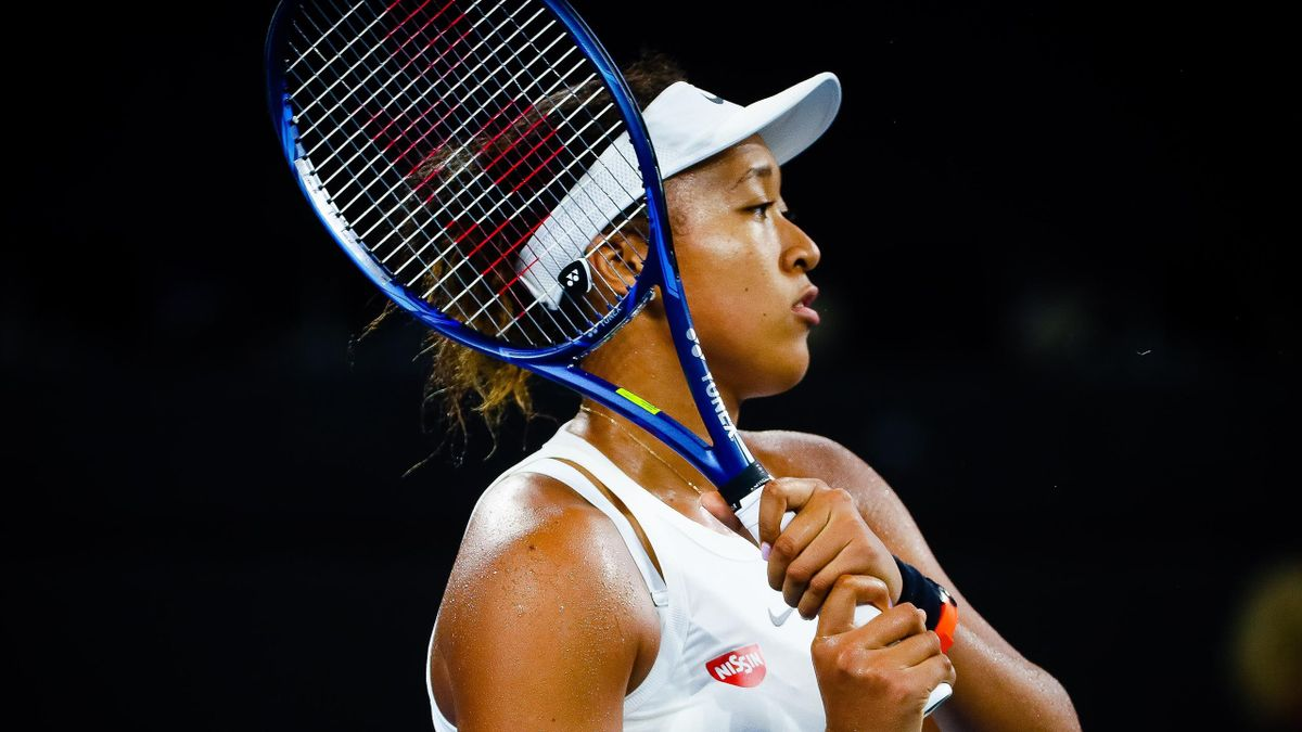 Naomi Osaka of Japan hits a return to Karolina Pliskova of the Czech Republic