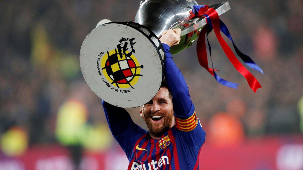 Barcelona's Lionel Messi celebrates winning La Liga with the trophy
