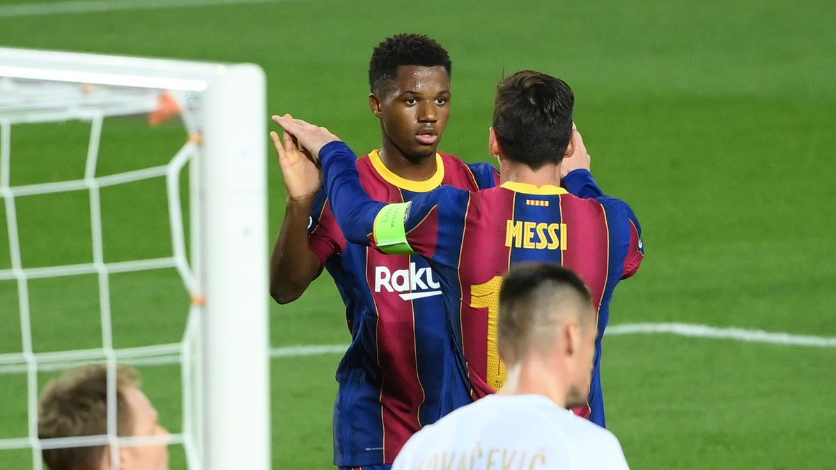 Barcelona's Spanish forward Ansu Fati (C) celebrates with Barcelona's Argentine forward Lionel Messi after scoring a goal during the UEFA Champions League football match between FC Barcelona and Ferencvarosi TC at the Camp Nou stadium in Barcelona on Octo