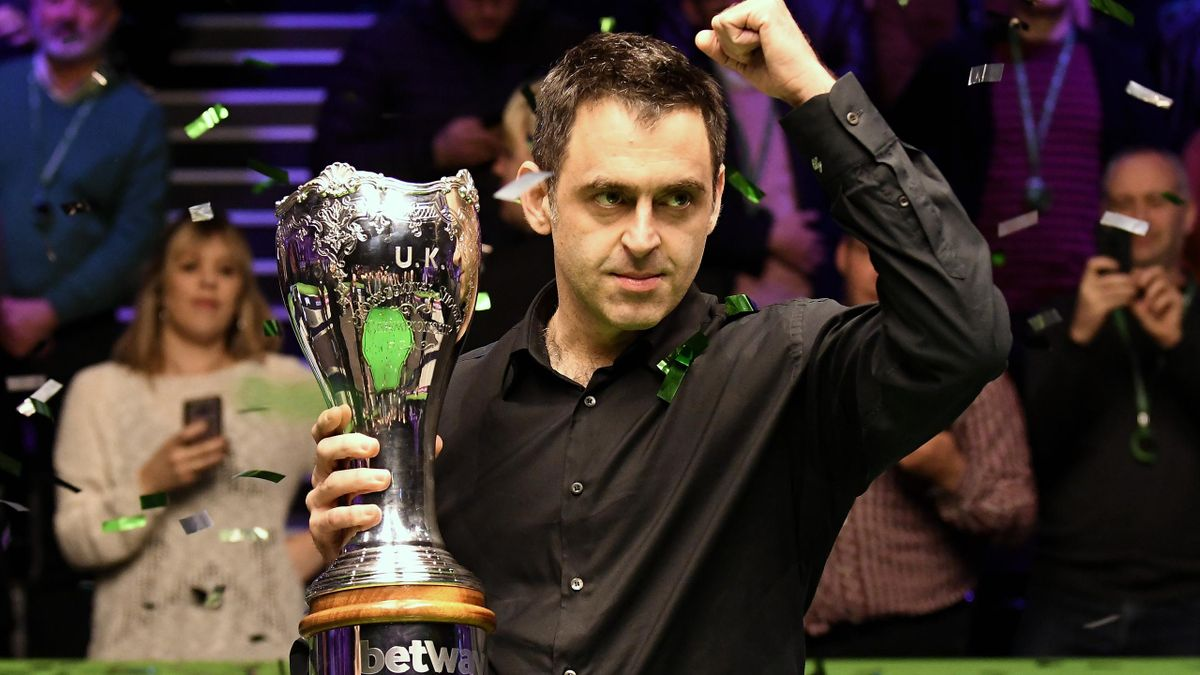 Ronnie O'Sullivan celebrates with the trophy after winning the final of the Betway UK Snooker Championship