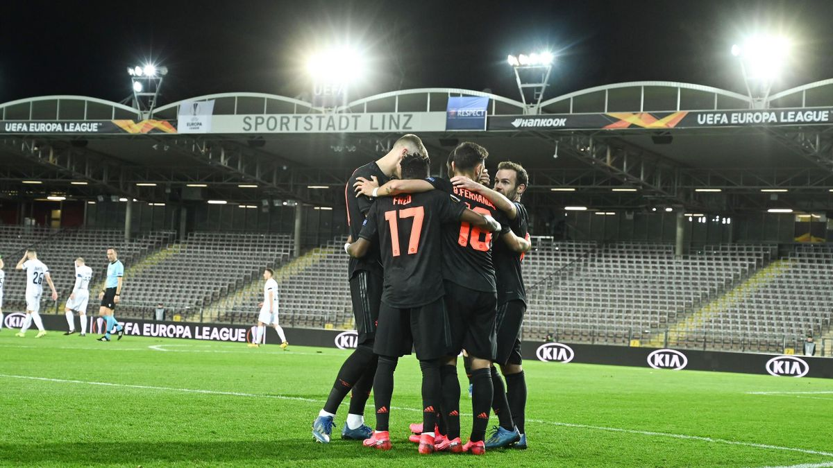 Manchester United's Nigerian forward Odion Ighalo (hidden) celebrates with his teammates after scoring during the round of 16 1st leg of UEFA Europa League football match between Linzer ASK (LASK) and Manchester United in Linz, Austria, on March 12, 2020.