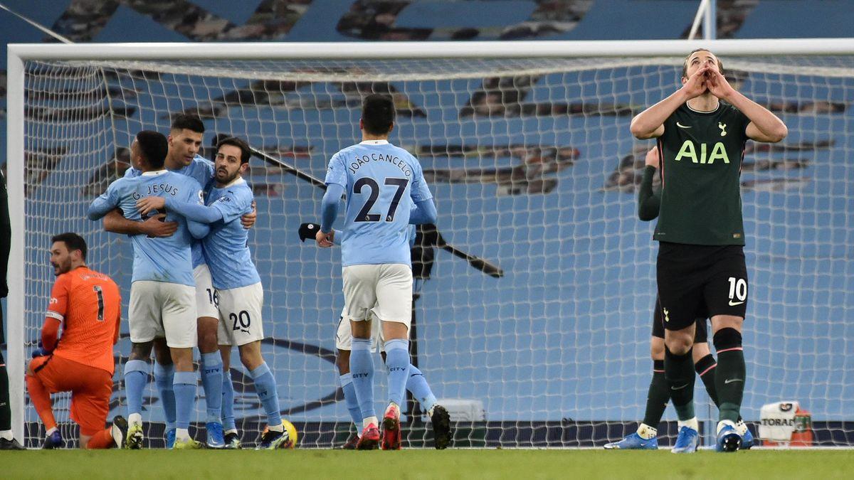 Tottenham Hotspur's English striker Harry Kane (R) reacts as Manchester City's Spanish midfielder Rodrigo (3L) celebrates