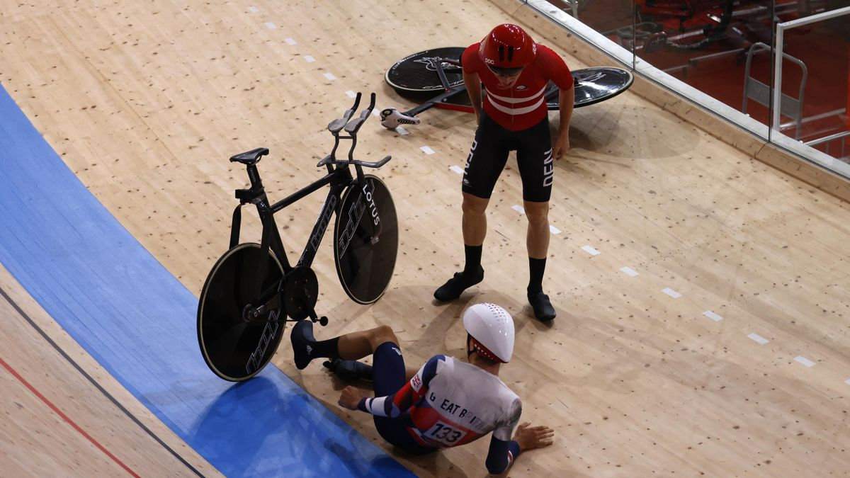 Denmark's Frederik Madsen reacts after crashed with Great Britain's Charlie Tanfiled during the first round heats of the men's track cycling team pursuit during the Tokyo 2020 Olympic Games at Izu Velodrome in Izu, Japan, on August 3, 2021.