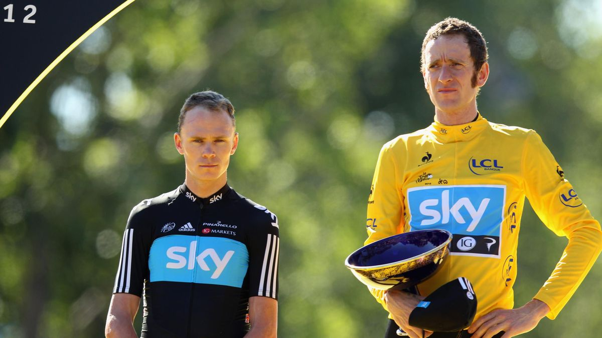 Bradley Wiggins of Great Britain and SKY Procycling (R) celebrates after receiving the maillot jaune on the podium and winning the general classificication as team-mate and runner up Christopher Froome looks on