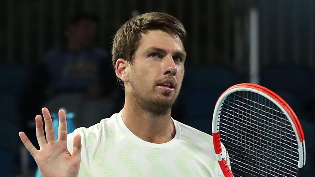 Cameron Norrie of Great Britain celebrates after winning match point in his Men's Singles first round match against Daniel Evans of Great Britain during day two of the 2021 Australian Open at Melbourne Park