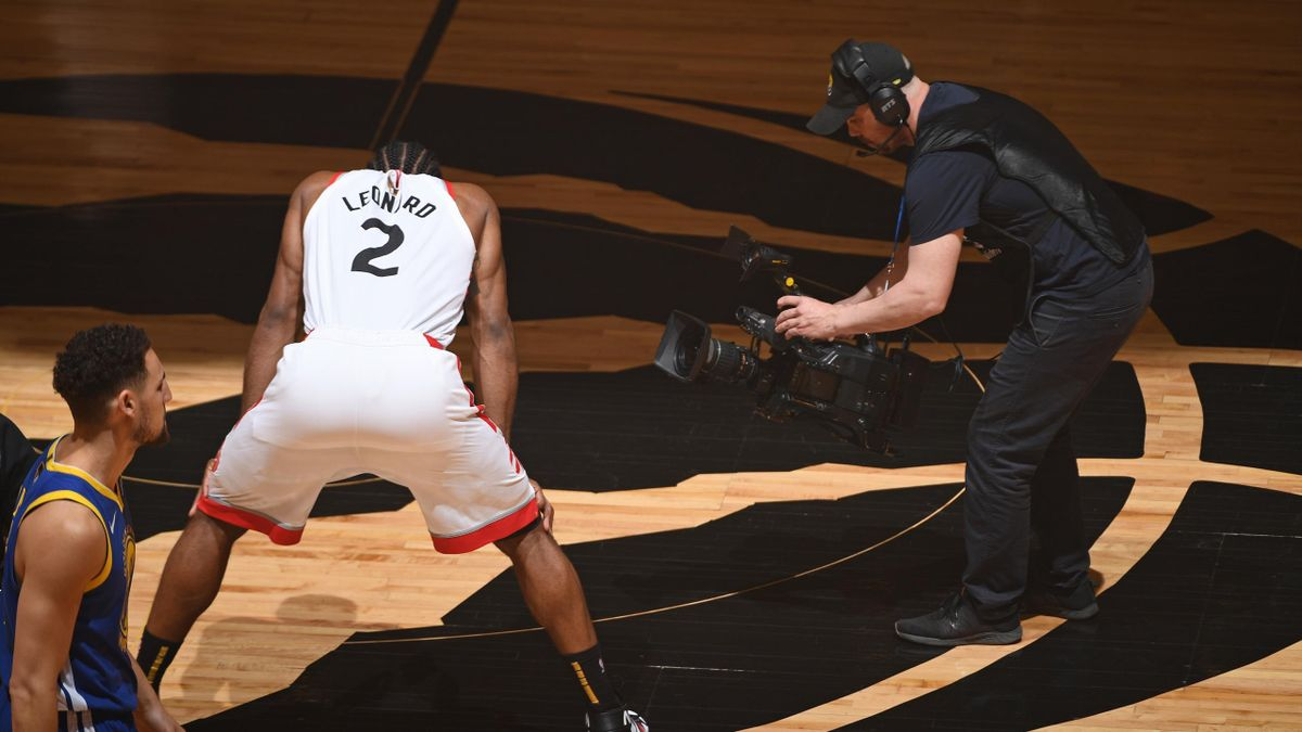 A camera man film Kawhi Leonard #2 of the Toronto Raptors before Game Five of the NBA Finals against the Golden State Warriors on June 10, 2019 at Scotiabank Arena in Toronto, Ontario, Canada.