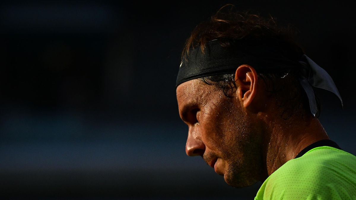 Spain's Rafael Nadal reacts during his men's singles semi-final tennis match against Serbia's Novak Djokovic on Day 13 of The Roland Garros 2021 French Open tennis tournament in Paris on June 11, 2021. (Photo by MARTIN BUREAU / AFP) (Photo by MARTIN BUREA