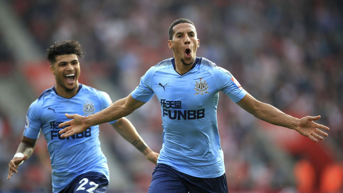 Newcastle United's Isaac Hayden, right, celebrates scoring his side's first goal of the game with teammate DeAndre Yedlin during their English Premier League