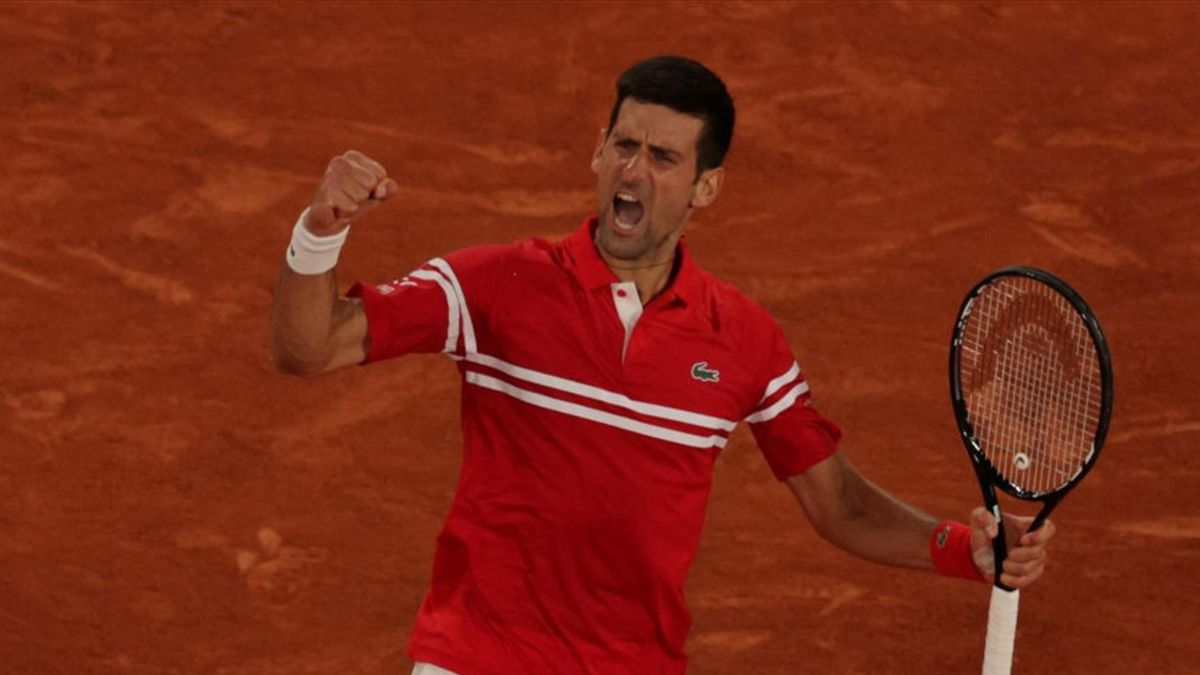 Novak Djokovic of Serbia celebrates during his Men's Singles Semi Final match against Rafael Nadal of Spain on day Thirteen of the 2021 French Open at Roland Garros on June 11, 2021