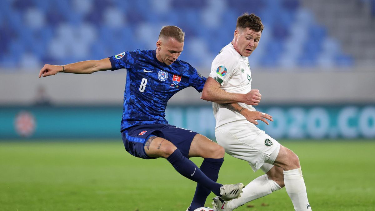 Ondrej Duda of Slovakia battles for possession with James McCarthy of Republic of Ireland