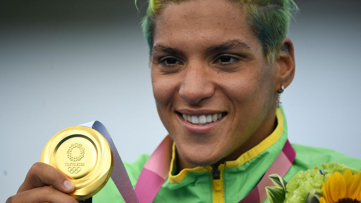 Brazil's Ana Marcela Cunha poses with her gold medal at a ceremony after winning the women's 10km marathon swimming event