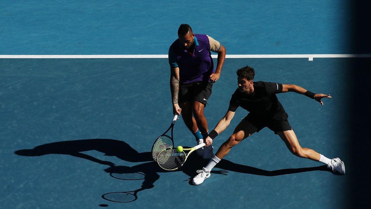 Thanasi Kokkinakis of Australia and Nick Kyrgios of Australia play in their Men's Double of the 2021 Australian Open