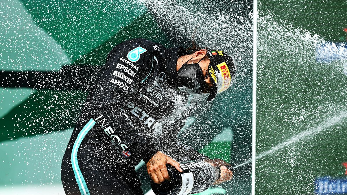 Race winner Lewis Hamilton of Great Britain and Mercedes GP celebrates with sparkling wine on the podium during the F1 Grand Prix of Portugal at Autodromo Internacional Do Algarve