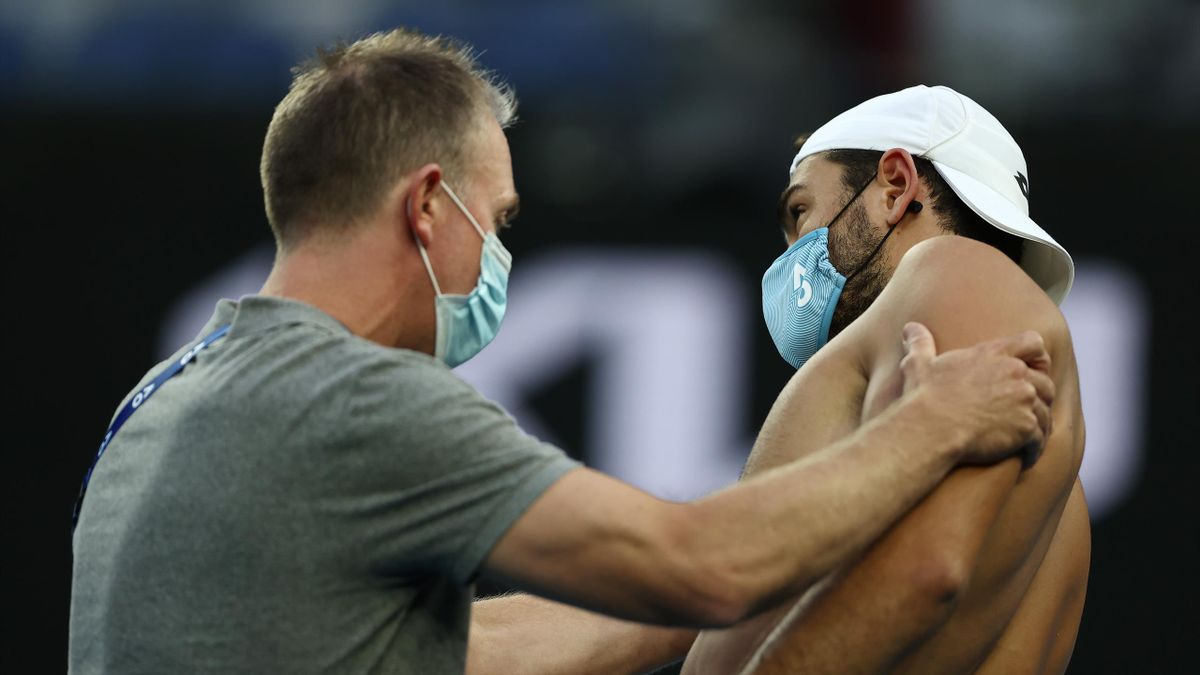 Matteo Berrettini of Italy receives medical treatment in his Men's Singles third round match against Karen Khachanov of Russia during day six of the 2021 Australian Open at Melbourne Park on February 13, 2021 in Melbourne, Australia