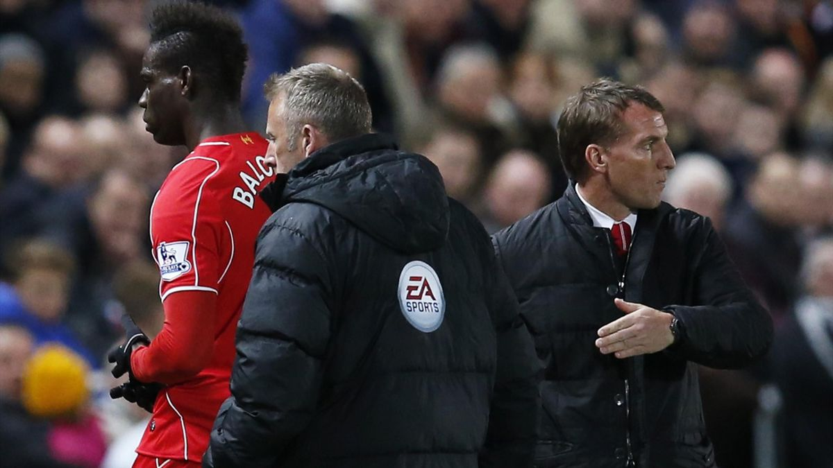 Liverpool's Mario Balotelli with manager Brendan Rodgers after being substituted