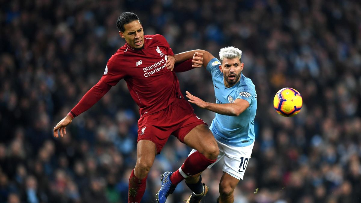 Sergio Aguero of Manchester City is fouled by Virgil van Dijk of Liverpool during the Premier League match between Manchester City and Liverpool FC at the Etihad Stadium