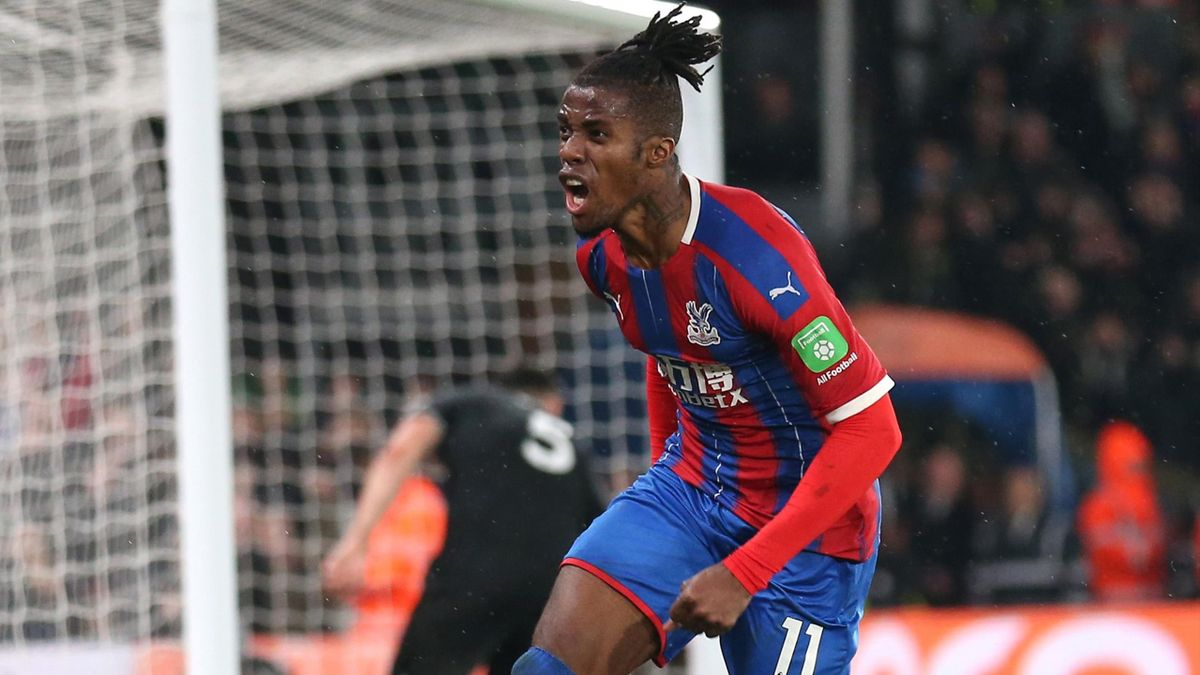 Wilfried Zaha of Crystal Palace celebrates after scoring his sides first goal during the Premier League match between Crystal Palace and Brighton & Hove Albion at Selhurst Park on December 16, 2019
