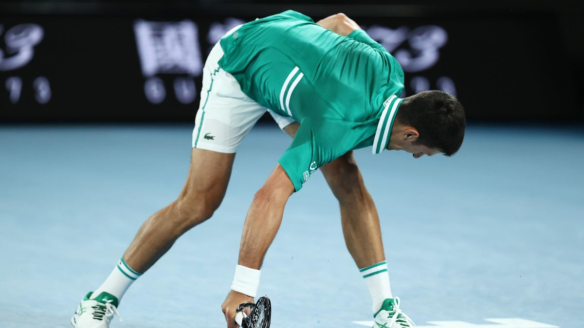 Novak Djokovic of Serbia smashes his racquet in his Men's Singles Quarterfinals match against Alexander Zverev of Germany during day nine of the 2021 Australian Open at Melbourne Park