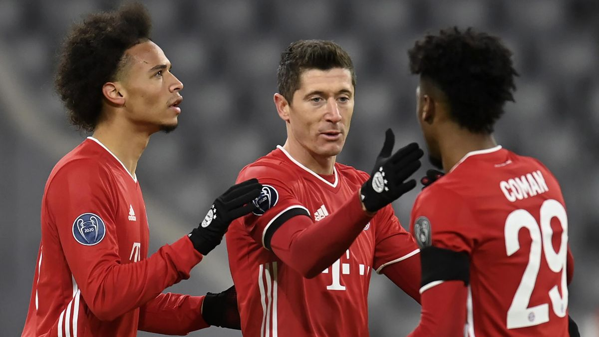 Bayern Munich's German midfielder Leroy Sane, Bayern Munich's Polish forward Robert Lewandowski and Bayern Munich's French forward Kingsley Coman