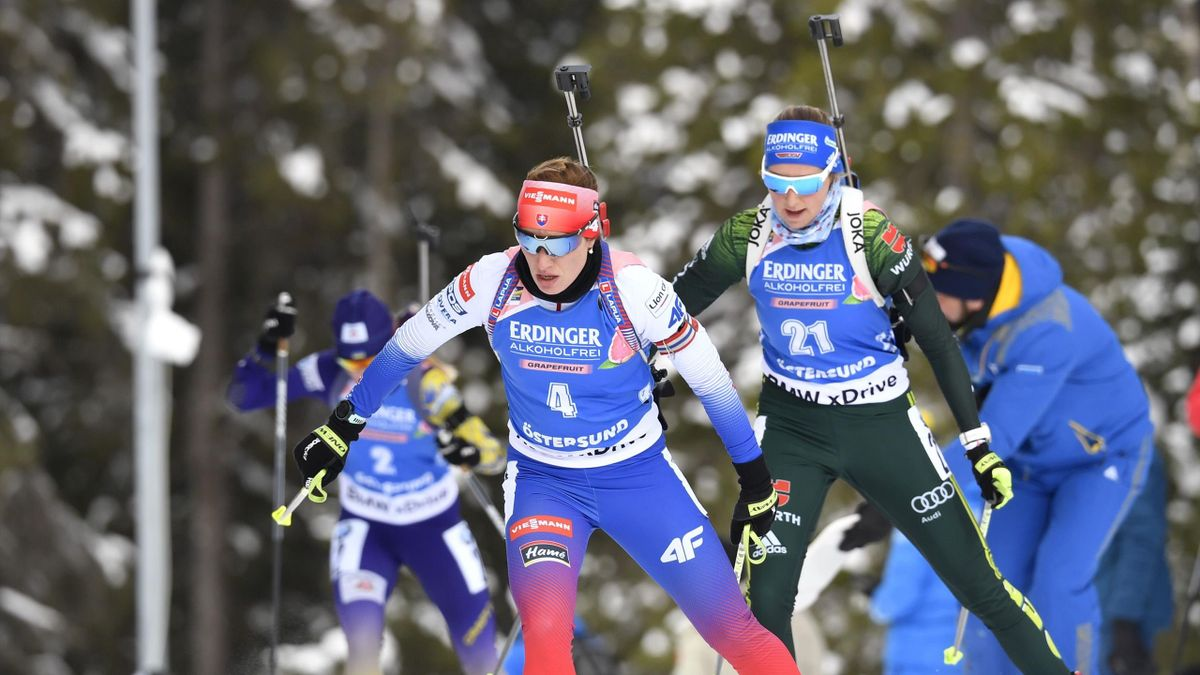 Slovakia's Paulina Fialkova (L) and Germany's Franziska Preuss compete in the women's 15km individual event at the IBU Biathlon World Championships in Ostersund, Sweden, on March 12, 2019.