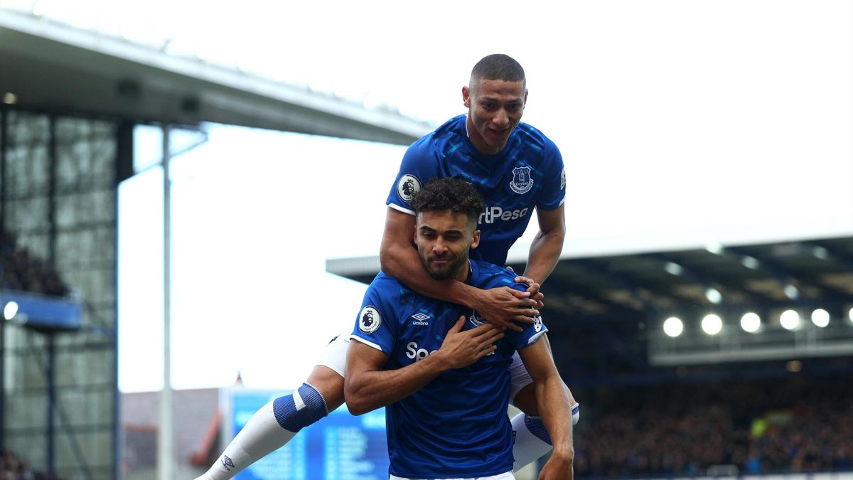 Dominic Calvert-Lewin of Everton celebrates after scoring his team's first goal with teammate Richarlison during the Premier League match between Everton FC and Manchester United at Goodison Park on March 01, 2020 in Liverpool, United Kingdom