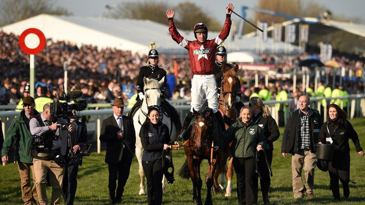 Jockey Davy Russell celebrates after riding Tiger Roll to victory in the Grand National Handicap Chase horse race on the final day of the Grand National.