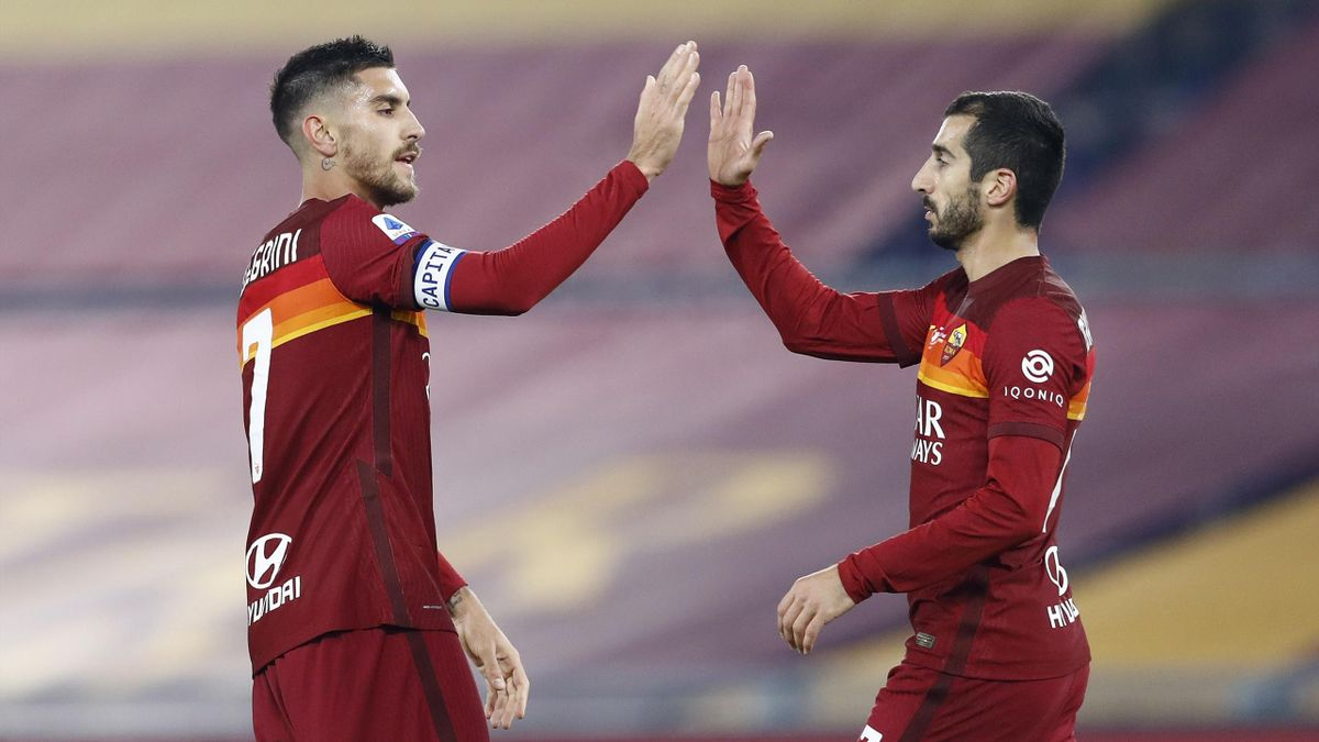 Lorenzo Pellegrini of AS Roma and Henrikh Mkhitaryan of AS Roma celebrate after scoring his team's third goal during the Serie A match between AS Roma and Torino FC at Stadio Olimpico on December 17, 2020 in Rome, Italy