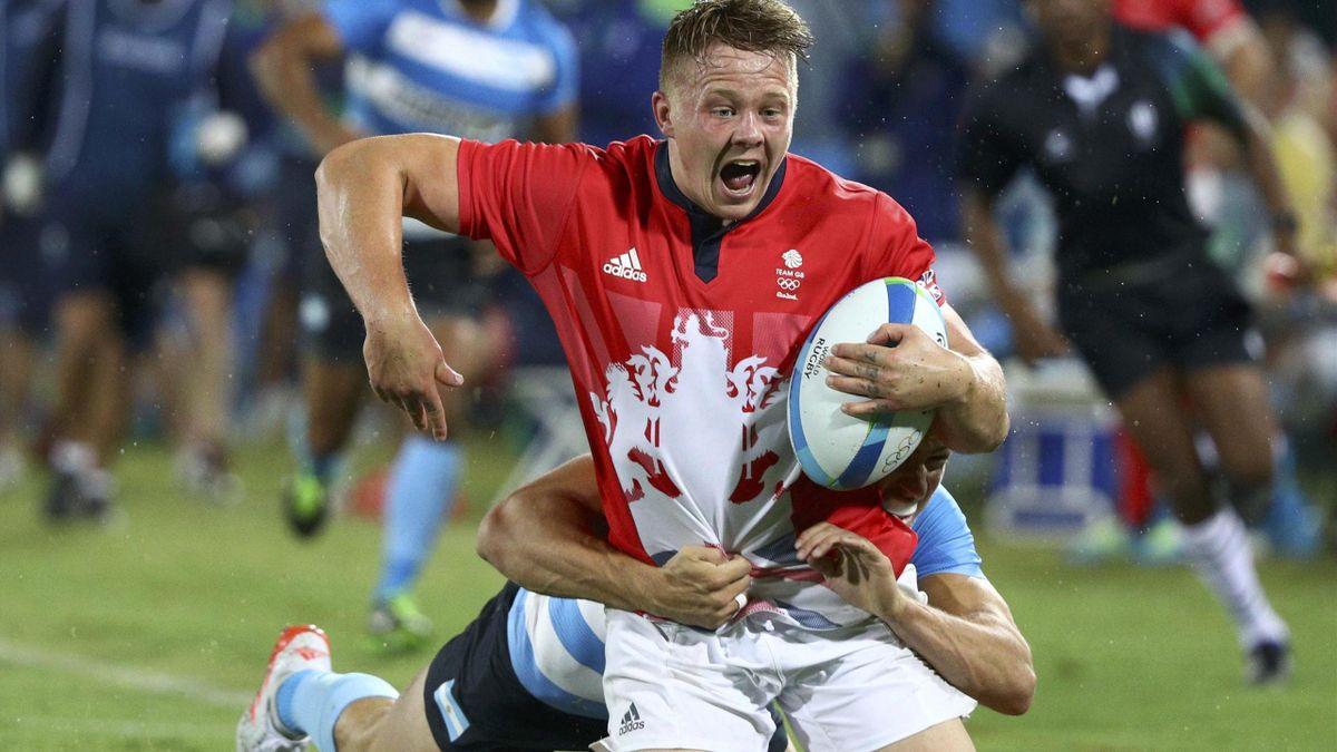 2016 Rio Olympics - Rugby - Men's Quarterfinals - Britain v Argentina - Deodoro Stadium - Rio de Janeiro, Brazil - 10/08/2016. James Davies (GBR) of United Kingdom is tackled.