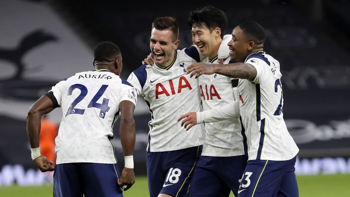 Tottenham Hotspur's Argentinian midfielder Giovani Lo Celso (2nd L) celebrates with teammates after scoring their second goal during the English Premier League football match between Tottenham Hotspur and Manchester City at Tottenham Hotspur Stadium