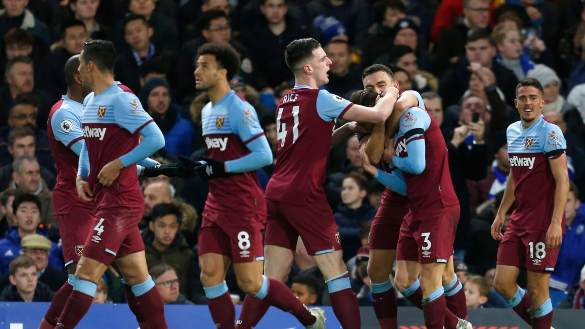 West Ham United's English defender Aaron Cresswell celebrates with Wteammates after he scores his team's first goal during the English Premier League football match between Chelsea and West Ham United at Stamford Bridge in London on November 30, 2019