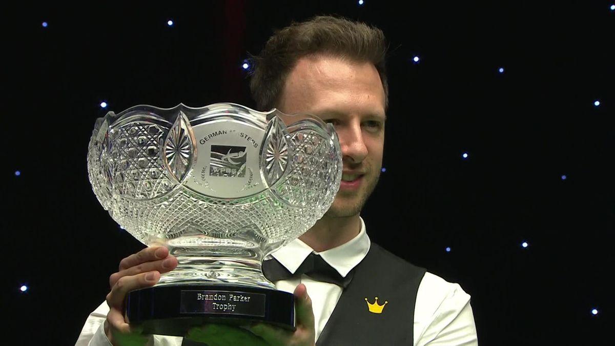 Judd Trump celebrates winning the 2021 German Masters