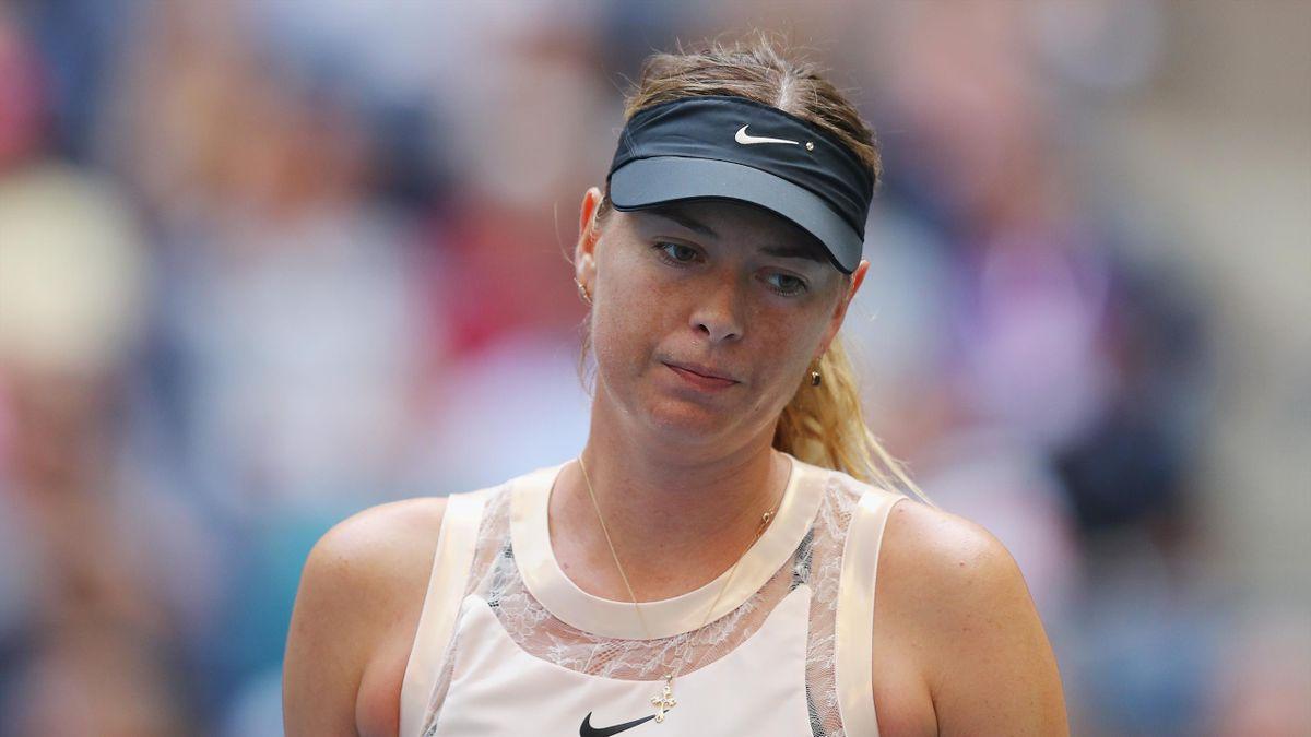 Maria Sharapova of Russia reacts during her women's singles fourth round match against Anastasija Sevastova of Latvia